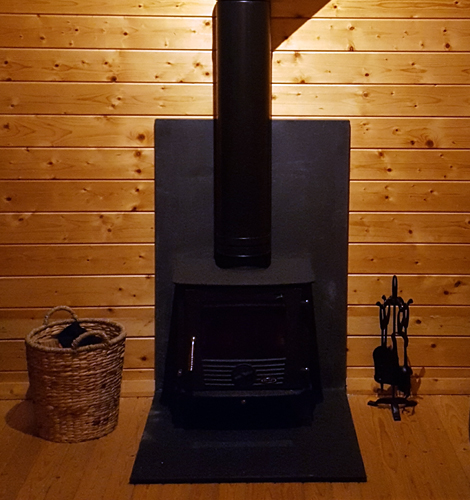 Wood burner in log cabin