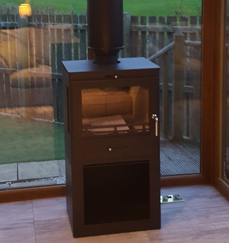 Wood burner in country house
